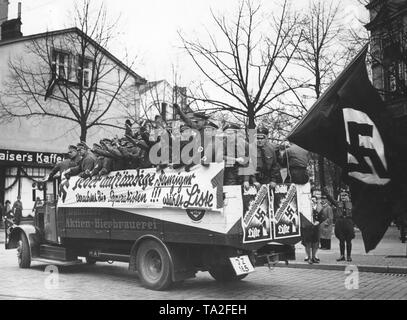 Photo of an election propaganda car of the NSDAP on the occasion of the Volkstag elections. On the banner on the side of the car the campaign slogan 'Every decent citizen of Gdansk despises the separatists! Vote for List 1 '. - Stock Photo