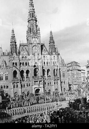 View of the town hall in Reichenberg (today Liberec) on October 9, 1938, during the occupation of the Sudetenland by German troops. German soldiers stand at the Townhall Square. - Stock Photo