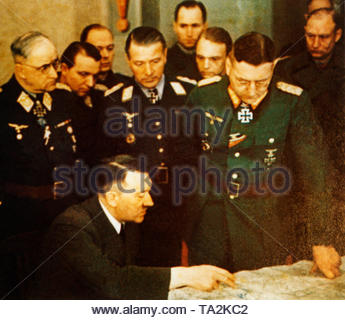 Adolf Hitler during one of his visits to the front in a meeting with from the left General Colonel Robert Ritter von Greim, General Major Franz Reuss, General of the anti-aircraft artillery Job Odebrecht and General Lieutenant Theodor Busse. - Stock Photo