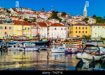 Harbour with tourist leisure boats and colourful houses in the centre of town, Mali Losinj, Losinj island, Croatia. May 2017. - Stock Photo