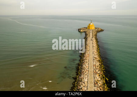 lignano sabbiadoro beacon lighthouse, view from a drone in a sunny day. green water and geometry lines Stock Photo