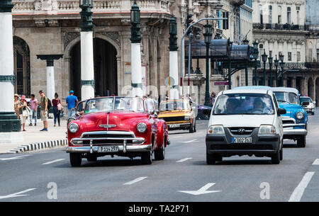 Havana, Cuba - 25 July 2018: Cars on the road and people walking around Old Havana City Cuba. - Stock Photo