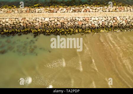 lignano sabbiadoro beacon lighthouse, piece of pier in long exposure. Perfect for your desktop photo Stock Photo