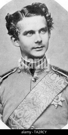 This photograph shows Ludwig II in Bavarian officer uniform as Crown Prince, a year before his takeover. After his deposition on June 9, 1886, his uncle Luitpold took over, as Prince Regent, the governmental affairs of the Bavarian kingdom. Due to his activity as builder of many well-known Bavarian castles, King Ludwig II received the nickname 'Fairy Tale King'. - Stock Photo