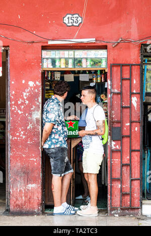 Havana, Cuba - 25 July 2018: Two men standing in the doorway of a storefront in Old Havana Cuba. - Stock Photo