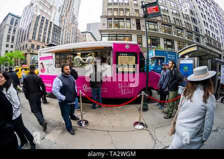 "A ""Carnegie Deli"" food truck promoting the Amazon Prime Video series ""The Marvelous Mrs. Maisel"" in New York on Tuesday, May 14, 2019.  The truck, a promotion for the series during the Upfronts, gave out free ""Midge"" and ""Suzie"" deli sandwiches and black & white cookies. The Upfronts are a series of events held by the networks to promote their shows to advertisers. (© Richard B. Levine) - Stock Photo"