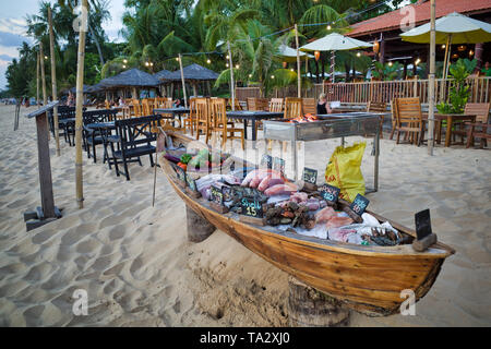 Phu Quoc island, Vietnam - March 30, 2019: Beach restaurant, fresh seafood and meat on the boat. - Stock Photo
