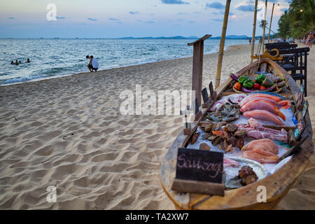 Phu Quoc island, Vietnam - March 30, 2019: Beach restaurant, fresh fish on the boat. - Stock Photo
