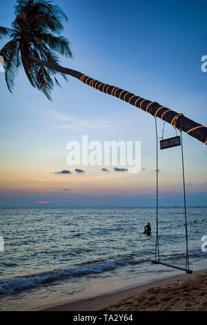 Swing on a palm tree. Sea beach at sunset. Spa Romance, Phu Quoc island, Vietnam