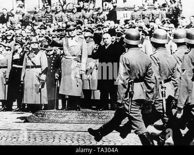 After the occupation of Bohemia and Moravia, a military parade of the Wehrmacht takes place at Wenceslas Square in Prague. Reichsprotektor of Bohemia and Moravia Konstantin Neurath stands next to Czech President Emil Hacha. Six months after the Munich Agreement, Hitler occupied the remaining areas of Bohemia and Moravia, and the first Slovak Republic was founded on his command. - Stock Photo