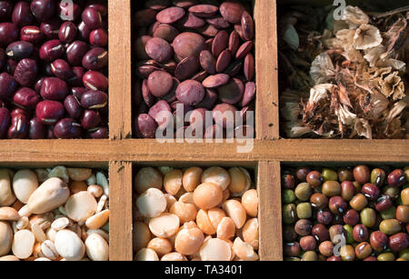 Different dry peas and lentils in wooden square compartments - Stock Photo