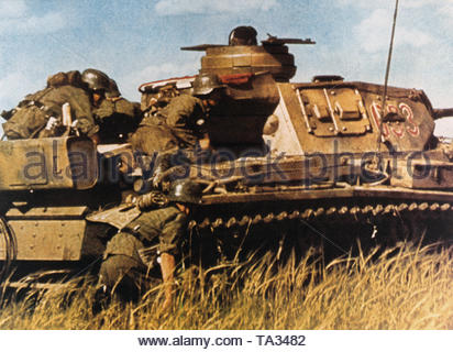 A Panzer III and accompanying infantry on the first day of the Russian campaign. - Stock Photo