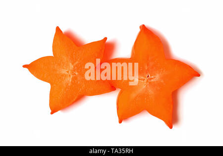 Two Sliced of Ripe Fresh Star Fruit in Vivid Orange Color Isolated on White Background - Stock Photo