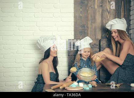Boy and girls in chef hats - Stock Photo