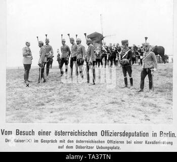 Emperor WilliamII (far left) in conversation with a deputation of Austrian officers in a cavalry exercise on the military training ground in the Doeberitz heath west of Berlin. - Stock Photo
