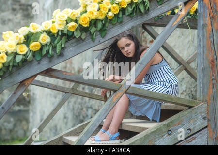 Valentines day or birthday, young girl with fresh rose flowers - Stock Photo