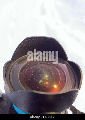 Frosted ultra wide angle lens front element at winter daylight. - Stock Photo