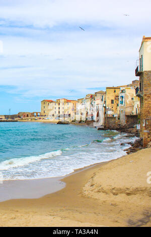 Old traditional houses in the harbour of beautiful Sicilian city Cefalu. The city located on the Tyrrhenian coast is on of the major tourist attractions in Italy. - Stock Photo