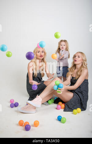 Happy family play with toy balls. - Stock Photo