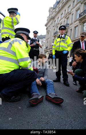 Police arrest Extinction Rebellion protester at Oxford Circus - Stock Photo