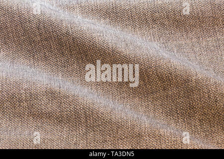 Brown waves dense rough fabric background, close up without any blurring - Stock Photo