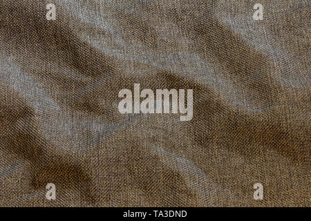Brown crumpled dense rough fabric background, close up withoun any blurring - Stock Photo