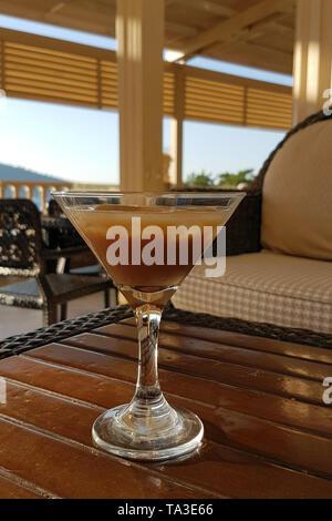 a coffee liqueur cocktail on a lobby bar table - Stock Photo