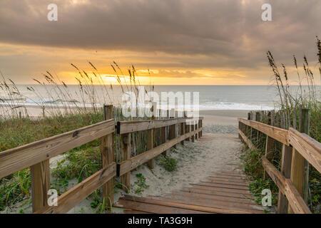 Sunrise along boardwalk over a sand dune in Myrtle Beach, South Carolina - Stock Photo