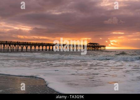 Morning sunrise along the ocean near pier in Myrtle Beach, South Carolina - Stock Photo