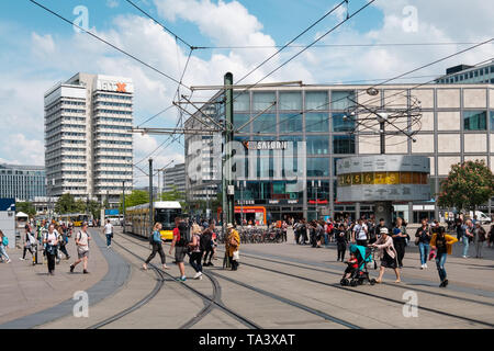 Berlin, Germany - May,  2019:  People on crowded street at Alexanderplatz square in Berlin city Center - Stock Photo