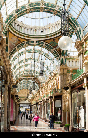 Shoppers walking through the County Arcade in  Leeds city centre, Yorkshire, England, UK - Stock Photo