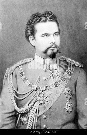 This photograph from 1875 shows King Ludwig II of Bavaria. King Ludwig II carries the Order of St. Hubert, the house order of the Wittelsbach and one of the four royal Bavarian orders.  After his deposition on June 9, 1886, his uncle Luitpold took over, as Prinzeregent, the governmental affairs of the Bavarian kingdom. Due to his activity as builder of many well-known Bavarian castles, King Ludwig II received the nickname 'Fairy Tale King'. - Stock Photo