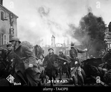 French soldiers take cover from a German air attack. Filmstill from the propaganda film 'Stukas' from the year 1941. - Stock Photo