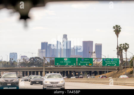 Los Angeles, California USA - May 2019: Downtown buildings skyline and signs on freeway indicating which lanes go to Los Angeles and which ones go nor - Stock Photo