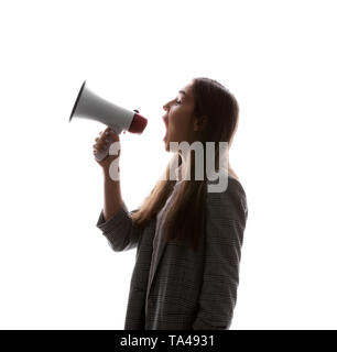 Silhouette of young woman with megaphone on white background - Stock Photo