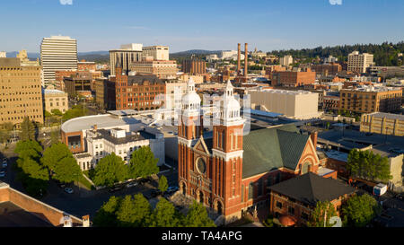 Rich late afternoon light falls onto the buildings and architecture of Spokane Washington USA - Stock Photo