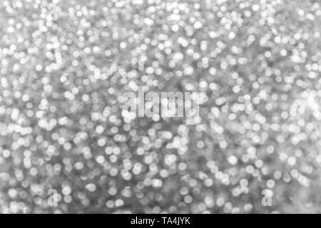 Blurred view of silver glitters - Stock Photo