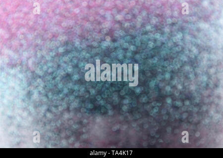 Blurred view of color glitters - Stock Photo