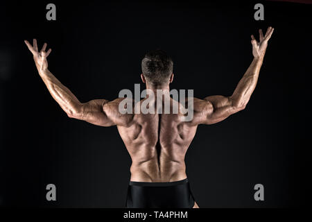 Macho handsome with muscular torso. Masculinity and sport. Improve yourself. Man muscular athlete. Attractive guy muscular body. Proud of excellent shape. Bodybuilder concept. Healthy and strong. - Stock Photo