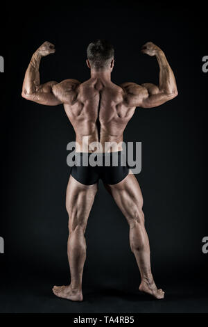 Healthy and strong. Macho handsome with muscular torso. Masculinity and sport. Improve yourself. Man muscular athlete. Attractive guy muscular body. Proud of excellent shape. Bodybuilder concept. - Stock Photo
