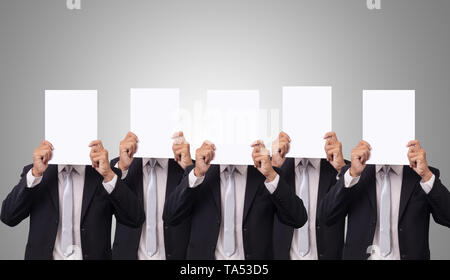 five Asian businessman cover her face with blank empty white paper for hide emotion - Stock Photo