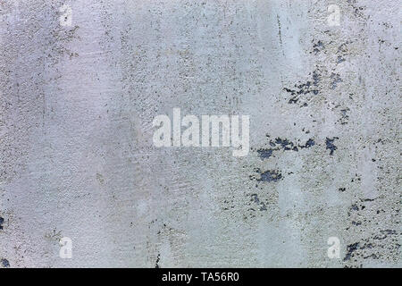 Beautiful texture of the pattern of grind gray concrete with black impregnations on the wall - Stock Photo