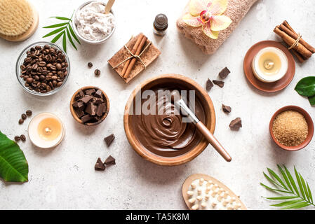Chocolate and Coffee Spa flat lay on white background, top view. Natural spa beauty products with coffee and chocolate. - Stock Photo