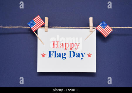 Greeting card with text Happy Flag Day for 14th June to celebrate adoption of Stars and Stripes as official flag of United States - Stock Photo