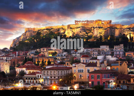 Panoramic view over the old town of Athens and the Parthenon Temple of the Acropolis during sunrise - Stock Photo