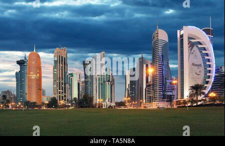 Doha city skyline city center at night, Qatar - Stock Photo