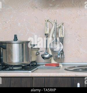 Different Kitchen Utensils - ladle, pan - Stock Photo