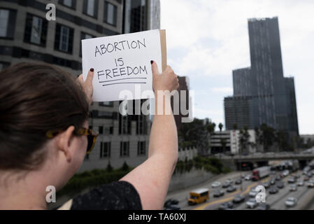 May 21, 2019 - Los Angeles, CA, United States - An activist seen holding a placard that says abortion is freedom during the protest..Women rights activists protested against restrictions on abortions after Alabama passed the most restrictive abortion bans in the US. Similar Stop the Bans Day of Action for Abortion Rights rallies were held across the nation. (Credit Image: © Ronen Tivony/SOPA Images via ZUMA Wire) - Stock Photo
