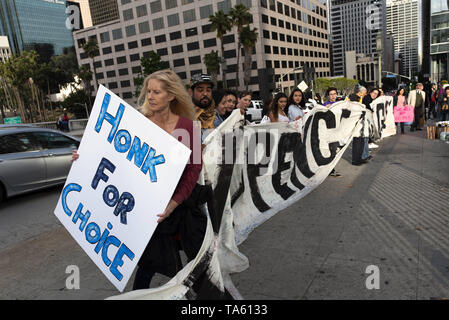 May 21, 2019 - Los Angeles, CA, United States - An activist seen holding a placard that says honk for choice during the protest..Women rights activists protested against restrictions on abortions after Alabama passed the most restrictive abortion bans in the US. Similar Stop the Bans Day of Action for Abortion Rights rallies were held across the nation. (Credit Image: © Ronen Tivony/SOPA Images via ZUMA Wire) - Stock Photo