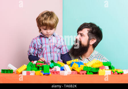 happy family. family leisure time. child development. building home with colorful constructor. father and son play game. happy little boy with bearded man dad playing together. happy family day. - Stock Photo